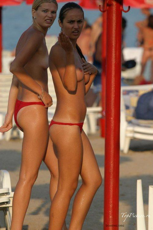 Girls sunbathing and swimming topless on the beach 17 photo